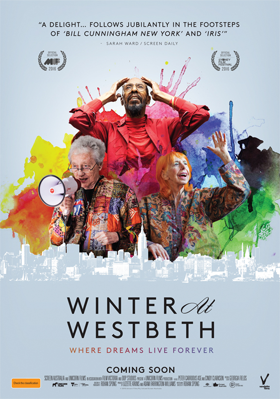 Promotional poster for the film Winter at Westbeth, containing an explosion of colour, behind a silhouette of Manhattan. Three older characters are featured - African American dancer Dudley Williams, dancer Edith Stephen and poet Ilsa Gilbert, who is brandishing a megaphone.